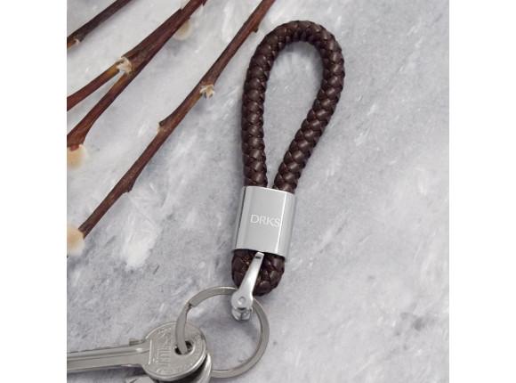 Bruine sleutelhanger van gevlochten leer