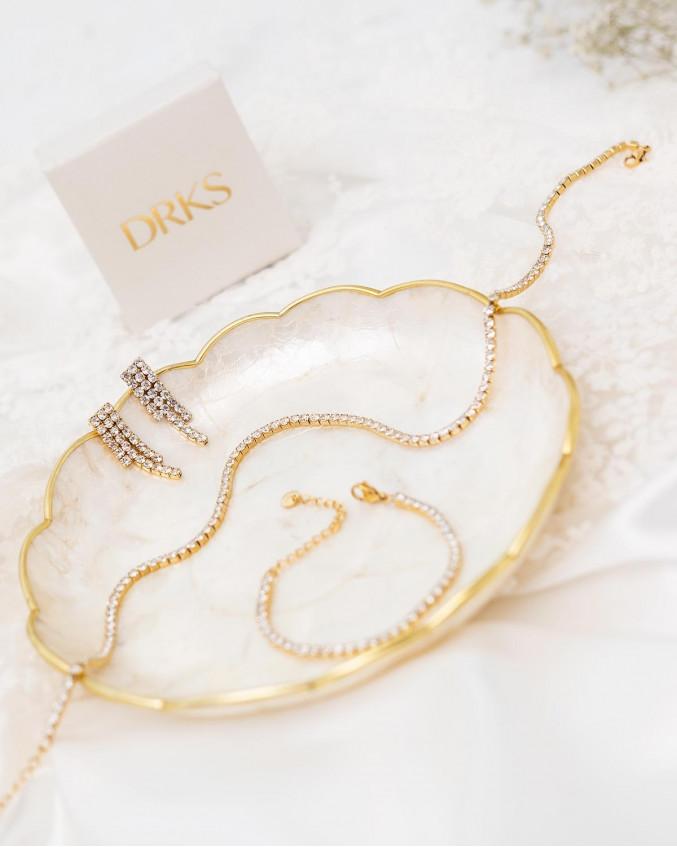 Mooie gouden sieradenset van de tennis collectie