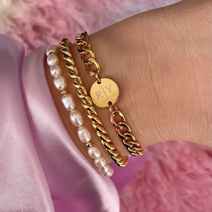 Gouden armparty met parels