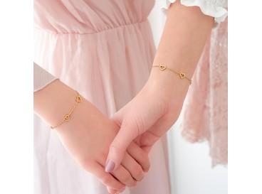 Gouden moeder en dochter armbandjes met hartjes