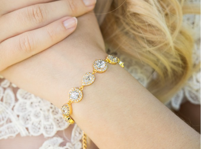 prachtige gouden armband met zirconia in diverse vormen