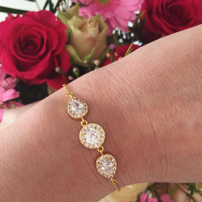 Gouden sparkle bruids armband met bloemen