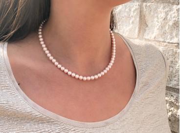 Elegante ketting met roze faux pearls
