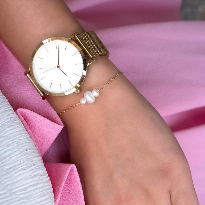 Mooie armband met drie zoetwater parels en goud