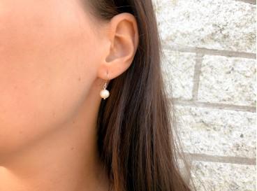 Prachtige sterling zilveren oorbellen met peach parel