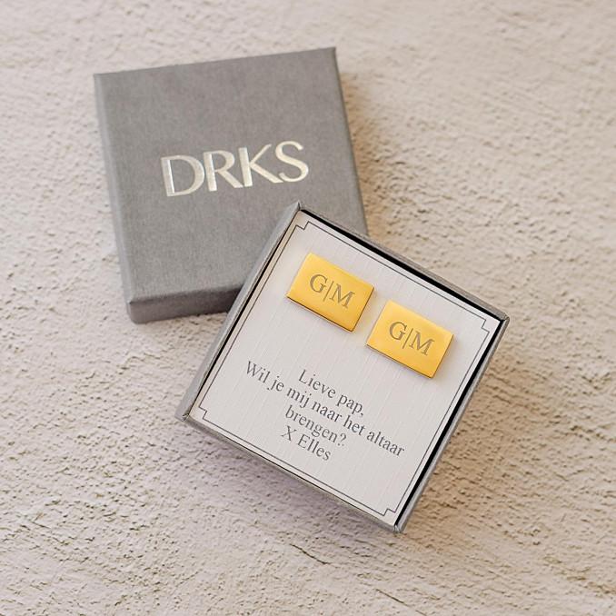 Gouden manchetknopen in doosje met tekst