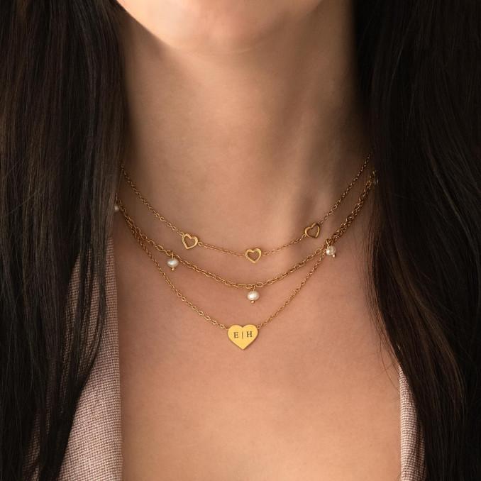 Trendy mix van gouden kettingen om de hals
