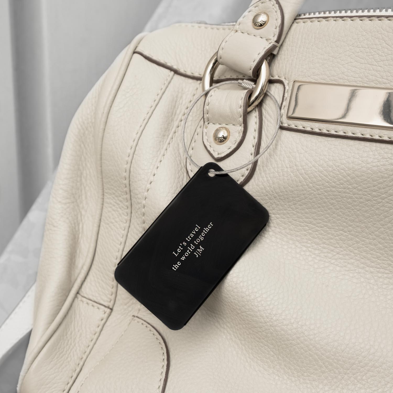 Zwartkleurige kofferlabel voor mee op reis