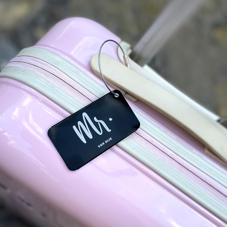 Kofferlabel voor hem voor om de tas