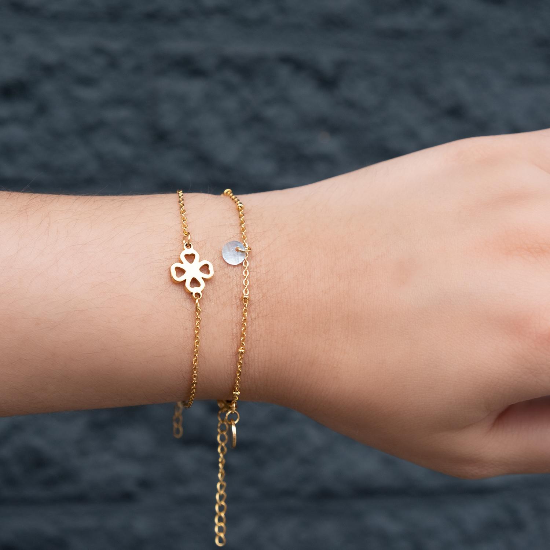 Gouden clover armband met armbandje met schelpje nieuw