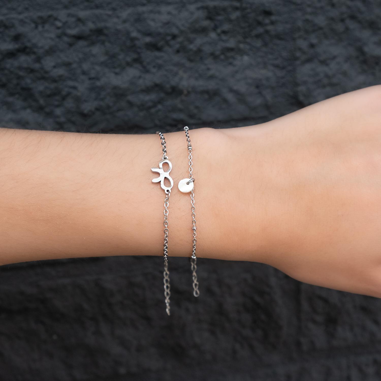 Armbandje met minimalistische schelp en bow armband