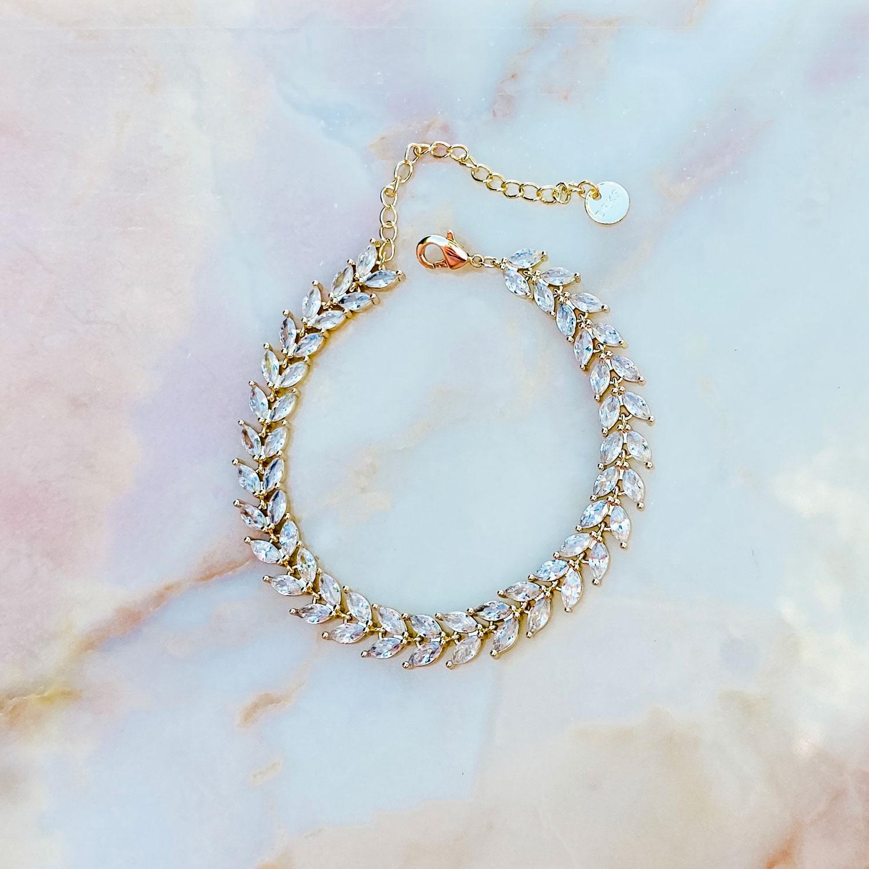Prachtige sparkle armband voor de bruid in een gouden kleur