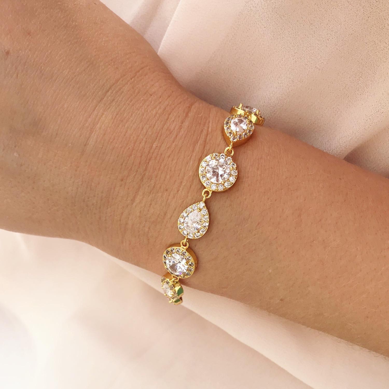 Woman wearing a beautiful DRKS daily luxury bracelet