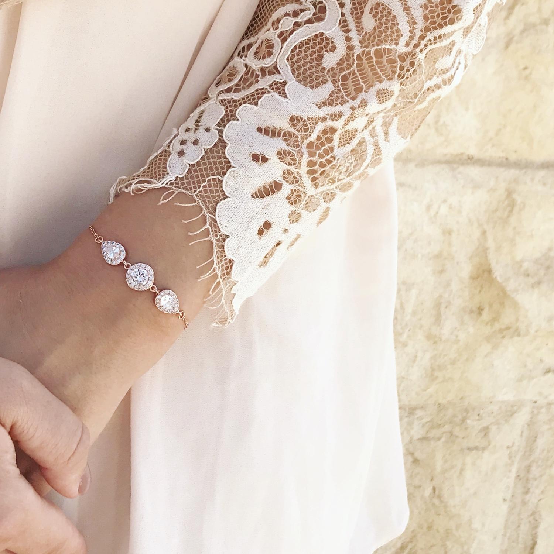 Bride wearing rose gold drks bracelet with zirconia
