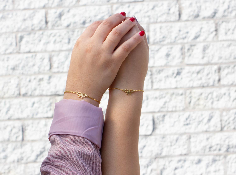 Moeder en dochter armband met strik in goud