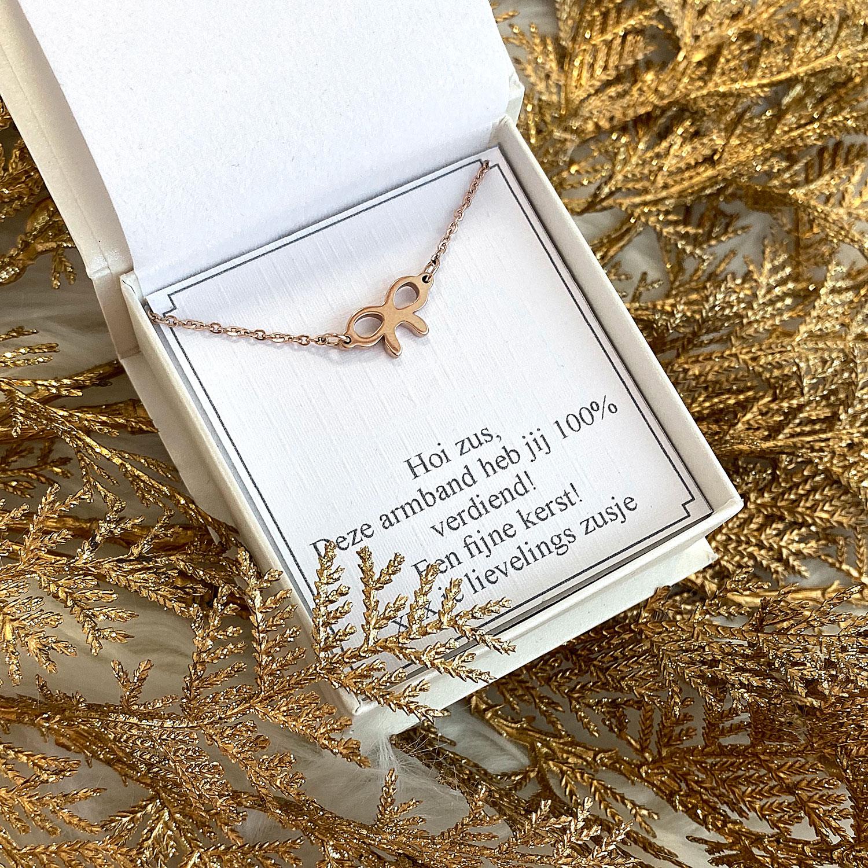 Rose gouden armband met een strikje in een sieradendoosje