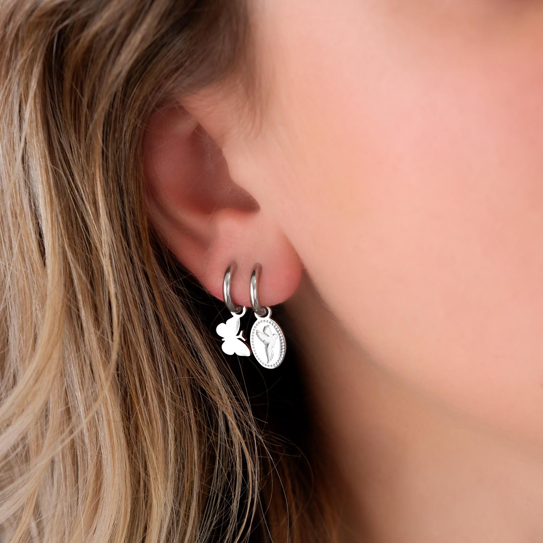trendy oorbellen met een hanger voor een mooie look