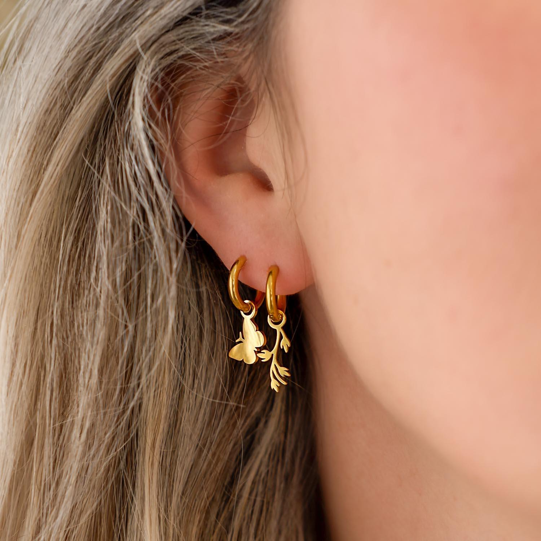 Gouden oorringetjes combinatie met leaves en vlinder