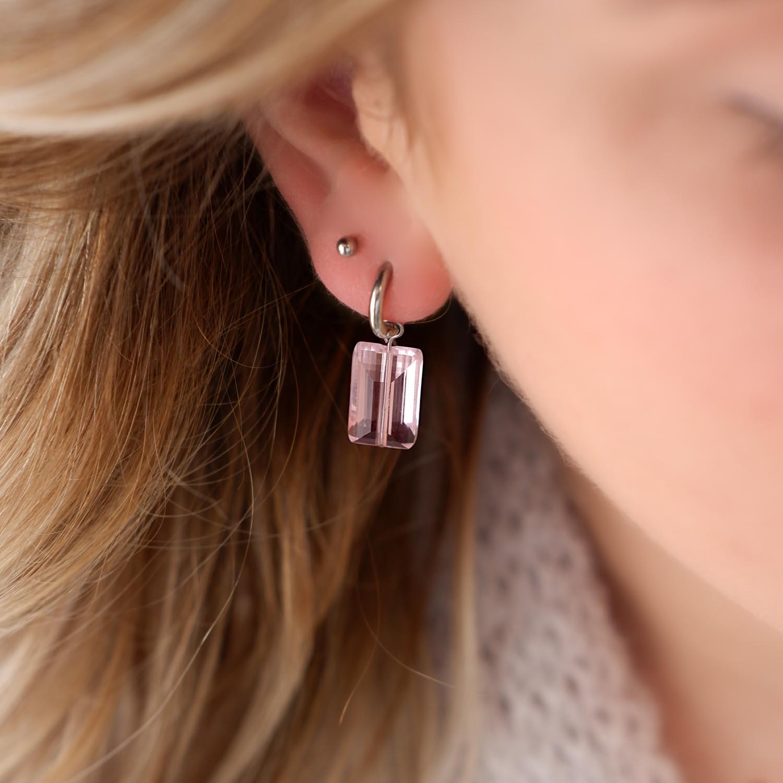 Oorbellen met roze steen gecombineerd met stud oorbel in de kleur zilver