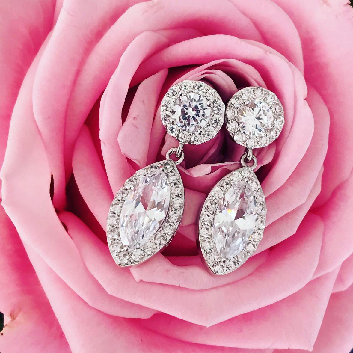 Zilveren sparkle oorbellen met roos