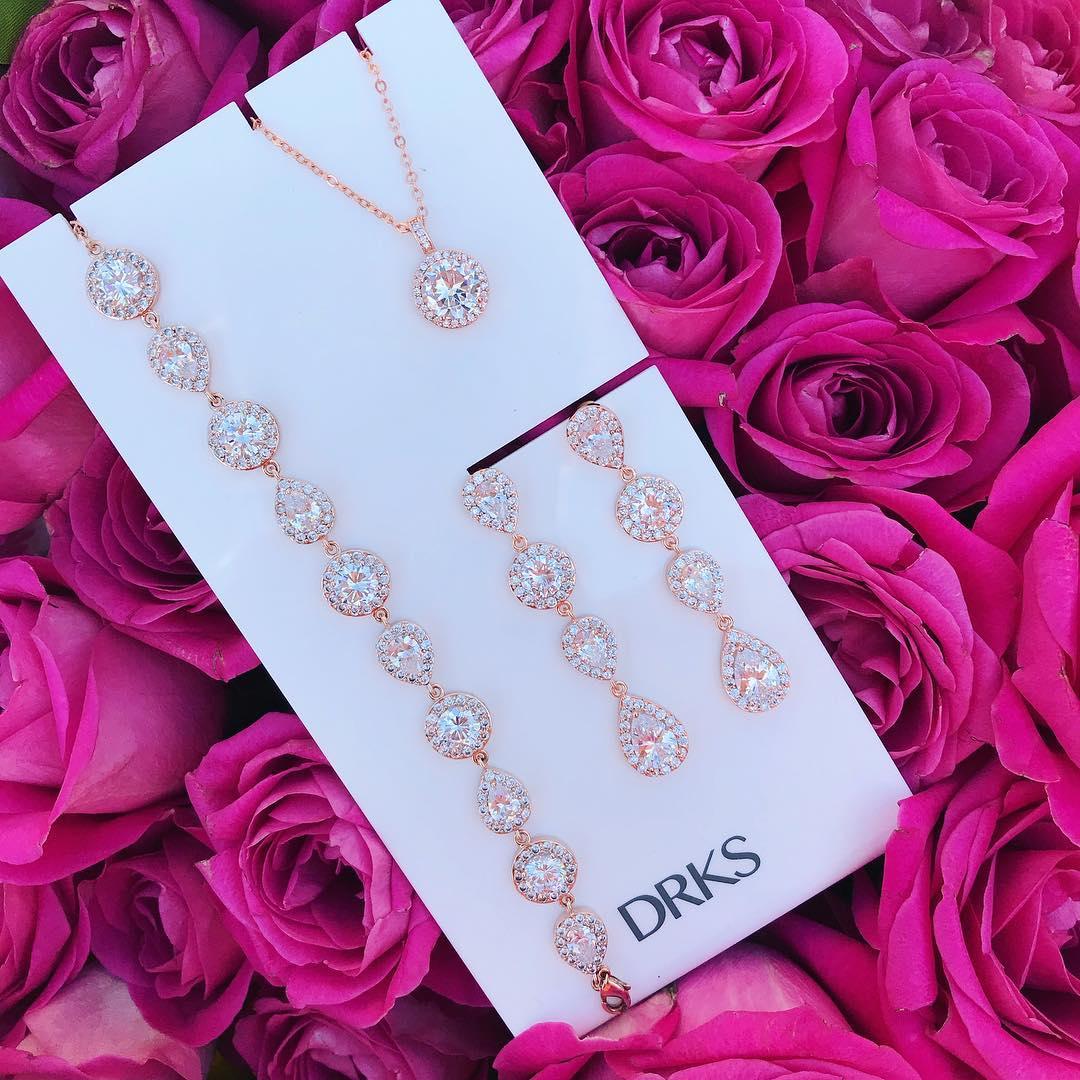 rose gouden oorbellen ketting en armband van drks