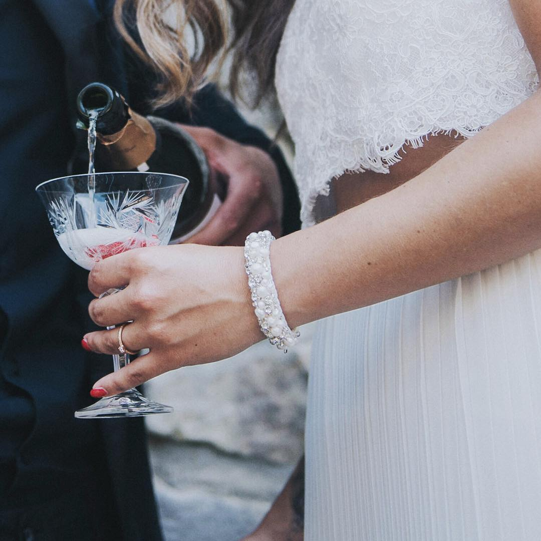 bride with champagne and bracelet