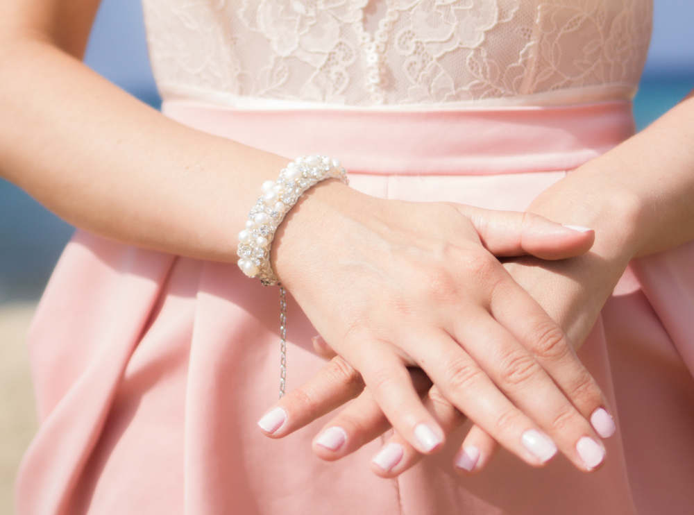 bracelet with pink skirt