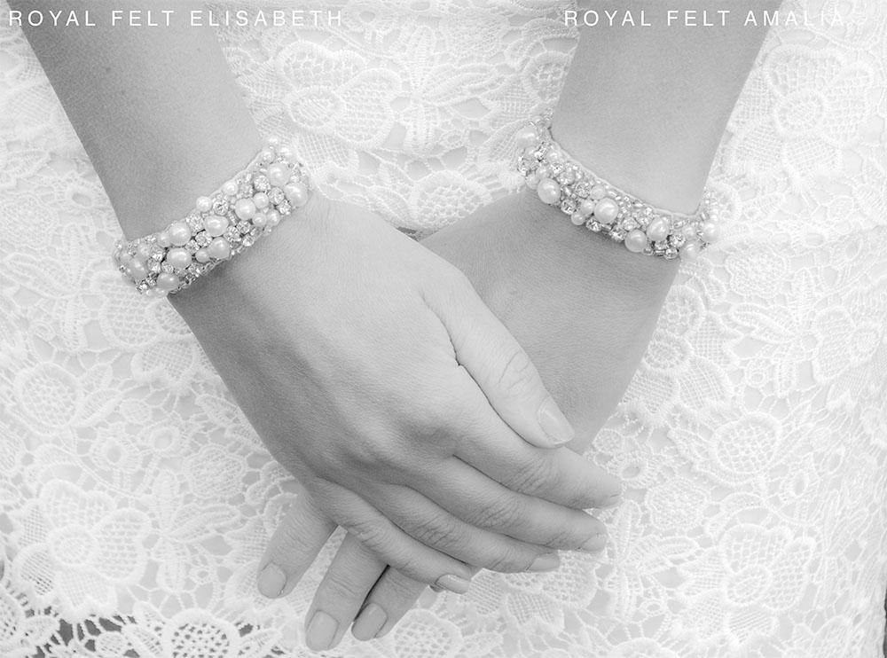 twee handen met armbanden