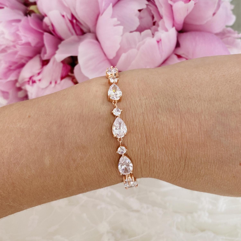 Rose gouden bruids armband met roze bloemen